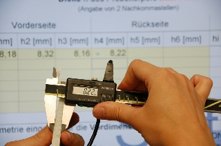 Mean combined thickness of a liner is measured using a precision slide gauge