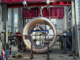 Modified vertical-compression test on large-calibre pipes