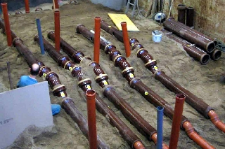 Construction of a sewer system for Comparative Tests at IKT's large-scale test facility