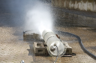 water spraying out of pipe
