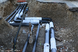 Open-trench installation of district-heating piping