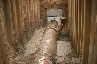 pipe in trench with liquid soil