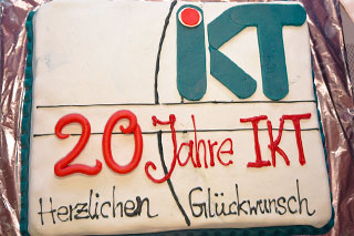 cake with decor 20 years at IKT congratulations