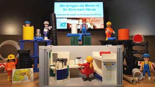trade show re-enacted with playmobil figures