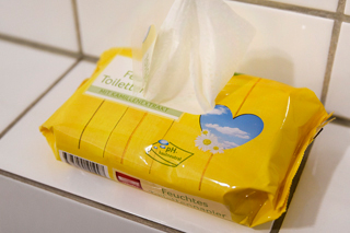 yellow pack of wet wipes on white tiles