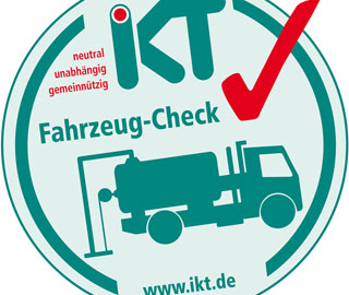 green and red test seal with pictogramme of sewer cleaning vehicle