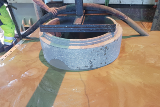 concrete manhole in test stand filled with flowable backfill
