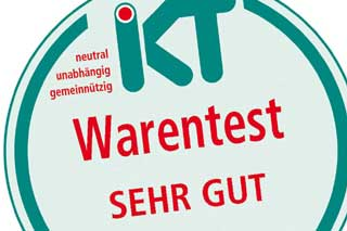 section of IKT compare seal with green and red writing