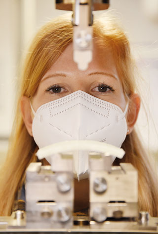 testing device in front of woman's face