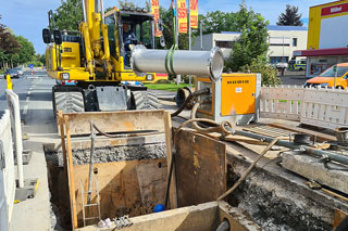 Sewer construction site with excavator